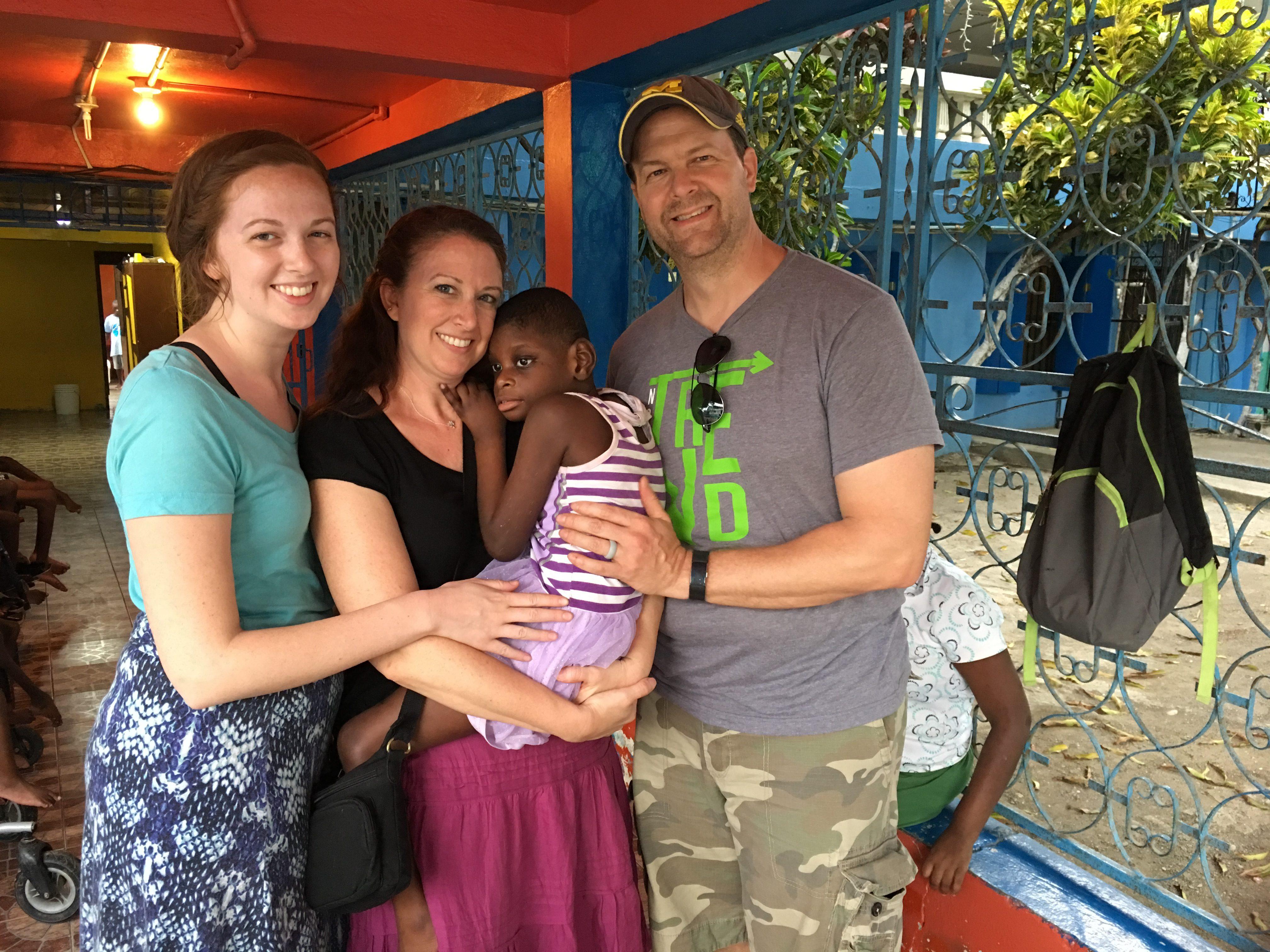 Todd, Kim, Hannah and their sponsor child, Gildine.